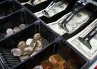 Le paiement, un critère de choix important du restaurant  - Caisse enregistreuse et dollars